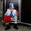 Magician sitting in a box — Stock Photo