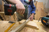 Working carpenter with drill. — Stock Photo