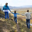 Happy  family walking in the mountains — Stock Photo