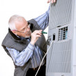 Man repairing air conditioning — Stock Photo
