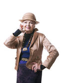 Senior blond woman in a hat with jacket — Stock Photo
