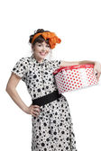 Happy girl holding gift box with red polka dots — Stock Photo