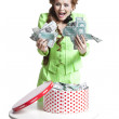 Surprised girl with money in a box — Stock Photo