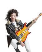 Girl  playing on electro guitar — Stock Photo