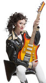 Girl   sitting on the chair with  electro guitar — Stock Photo