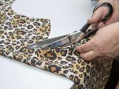 Dressmaker cutting fabric — Stock Photo
