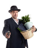 Businessman  with gun  hold  personal belongings — Stock Photo