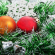 Two Christmas ball in green garland with bells and white snowfla — Stock Photo #36752739