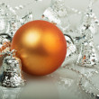 Orange Christmas ball with silver bells — Stock Photo
