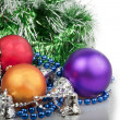 Three Christmas balls with blue beads, green garland and silver — Stock Photo