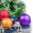Three Christmas balls with blue beads, green garland and silver — Stock Photo #36752751