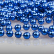 Blue christmas beads — Stock Photo
