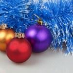 Three Christmas balls with blue garland — Stock Photo #36752841