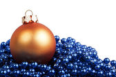 Orange Christmas ball and blue beads — Stock Photo