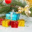 Many bright Christmas gifts under the tree — Stock Photo