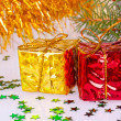 Stock Photo: Two Christmas gifts under tree
