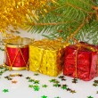 Two Christmas gifts under the Christmas tree with red drum — Stock Photo #36962817