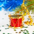Red drum under the tree with gold beads — Stock Photo