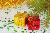 Two Christmas gifts under the tree — Stock Photo