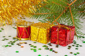 Two Christmas gifts under the Christmas tree with red drum — Stock Photo