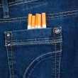 Cigarettes in blue jeans pocket — Stock Photo #37173767