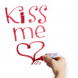 Female hand writing kiss me marker on a white background — Stock Photo