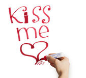 "Female hand writing ""kiss me"" marker on a white background — Stock Photo"