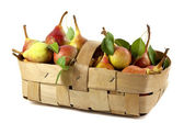 Sweet pears in a basket — Stock Photo