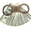 Stack of money and handcuffs — Stock Photo