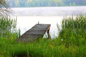 Dock on the river — Stock Photo