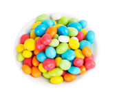 Colored candies in white saucer — Stock fotografie