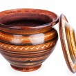 Open clay pot with a lid — Stock Photo #40127789