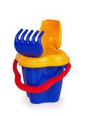 Shovel and rake sand in a bucket — Stock Photo