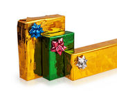 Three colored beautiful boxes with gifts — Stock Photo