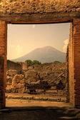 Ruins in Pompeii and in background Vesuvius, Italy — Stock Photo