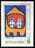 BULGARIA- CIRCA 1980: a stamp printed in Bulgaria, shows a child's drawing of a spaceship with astronauts, CIRCA 1980 — Stock Photo