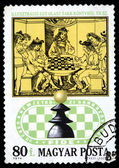HUNGARY - CIRCA 1974: a stamp printed in Hungary shows a King plays chess. CIRCA 1974 — Stok fotoğraf