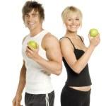 uomo e donna mangiare sano isolato su sfondo bianco — Foto Stock