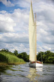 Norfolk Broads sail boat sailing on a river — Stock Photo