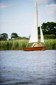 Norfolk Broads sail boat on a river by the bankment — Stock Photo