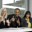 Work colleagues happy in a meeting — Stock Photo