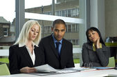 Work colleagues at a meeting — Stock Photo