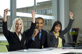 Three colleagues cheering in a meeting — Stock Photo