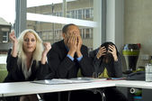 Stressed work colleagues in a meeting — Stock Photo