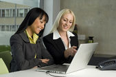 Two beautiful business women working together — Stock Photo