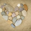 Pebbles arranged in a heart shape — Stock Photo