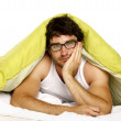 Man tired in bed under a green duvet — Stock Photo #34640965