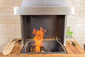 Fire in the modern bbq grill oven — Stock Photo