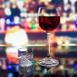 A glass of wine and a shot of vodka — Foto Stock