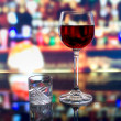 A glass of wine and a shot of vodka — Stockfoto